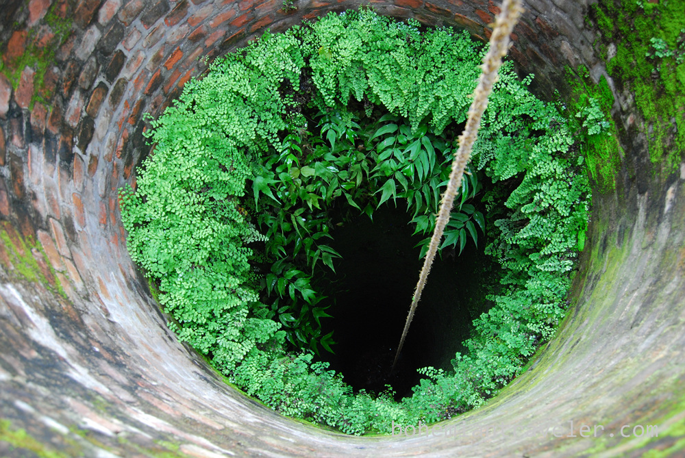 Looking into a well.