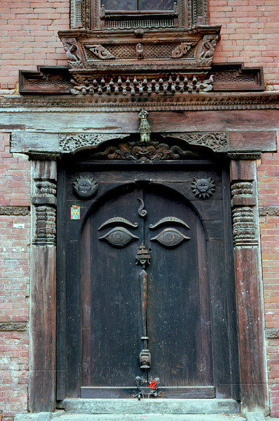 Old Carved Doorway with Buddha's Eyes, Durbar Square of Bhaktipur, Nepal
