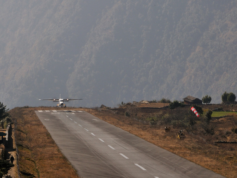 Landing in Lukla. There is a single runway which is 400m long, and slopes upwards. At an altitude of 2680m, there are a limited number of types of aircraft that can operate in and out of Lukla.