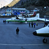 Waiting for takeoff in Lukla.  There was no space to park the most distant aircraft in this picture so it is parked at the end of the runway.
