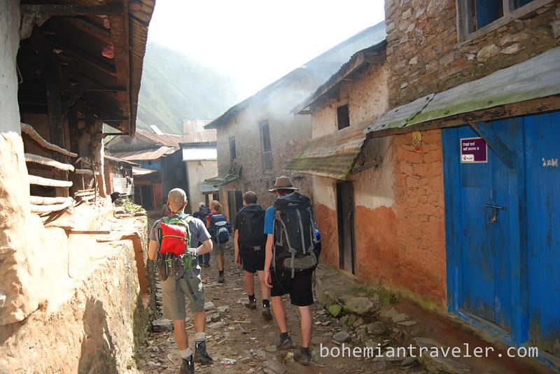 Walking through a village.