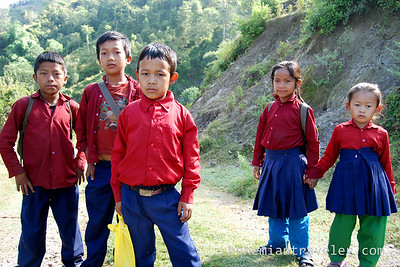 Nepalese school kids pose on their way to school in the morning.