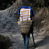 Porter carrying supplies (in this case flats of beer) up the steep trail to Namche Bazaar.