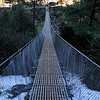 Suspension bridge. Bridges of this type are crossed frequently on the trail between Lukla and Namche Bazaar.