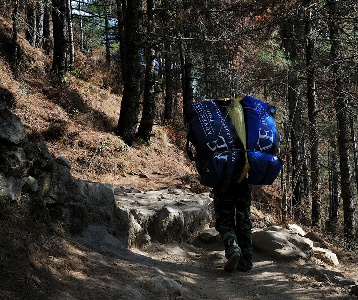 Porter carrying some of our bags up to Namche Bazaar. Each bag weighed around 35lbs.