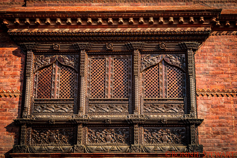 Wood Carved window coverings over the shops in the Monkey Temple