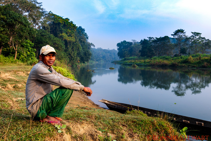Captain of the boat guiding the  visitors through Nepal's Chitwan National Forest