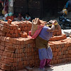 Laborer ( I watched this woman carry load after load of bricks)