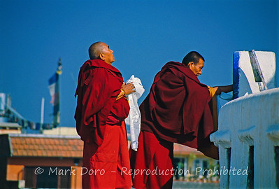 Monks praying at Boudhanath Stupa, Kathmandu, Nepal