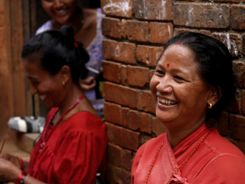Women that works as a tailors seated on the pavements in Bhaktapur.