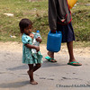 "<strong><center>The Water Carrier<br> Water is a key component in determining the quality of our lives. It is more important than oil and gold - and in some areas they learn at an early age the importance of saving and caring for their supply. This photo is taken in  <a href=""http://en.wikipedia.org/wiki/Pokhara"" target=""_blank""><span style=""color: #0080ff;"">Pokhara</span></a>, in Nepal. It is a remarkable place of natural beauty, situated at an altitude of 827m from the sea level and  200km west of The Kathmandu valley.  This little girl had her chores, carrying water for the family, she stands in our memory as the reminder of water conservation and how we take resources  for granted in our part of the world.  It would help her, and many others like her, if you would reduce your resource usage.  <span style=""color: #333333;"">.</span>"