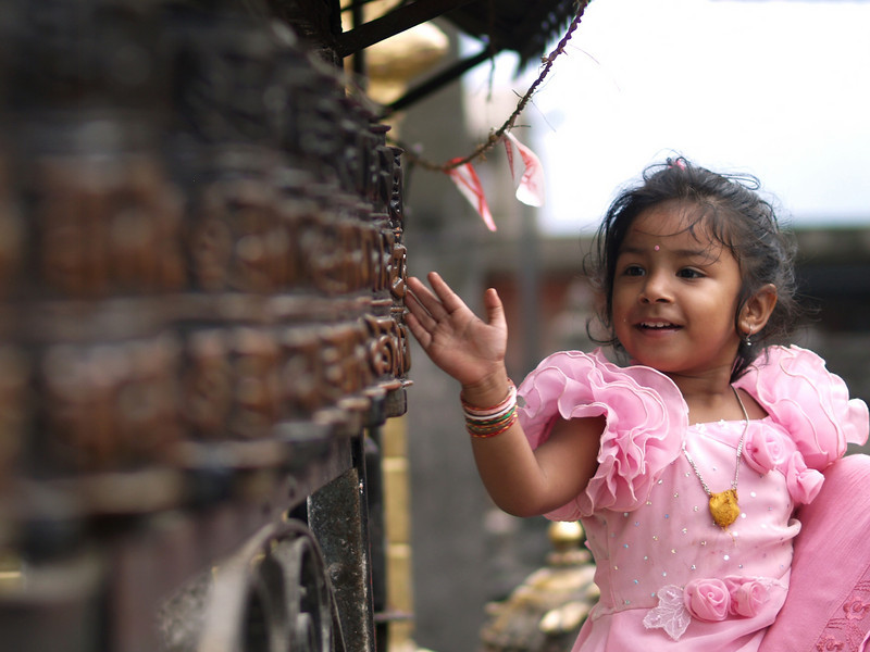 Cheerful child in the Monkey temple at Katmandu