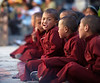Monk taking a break from watching the Tiji Festival