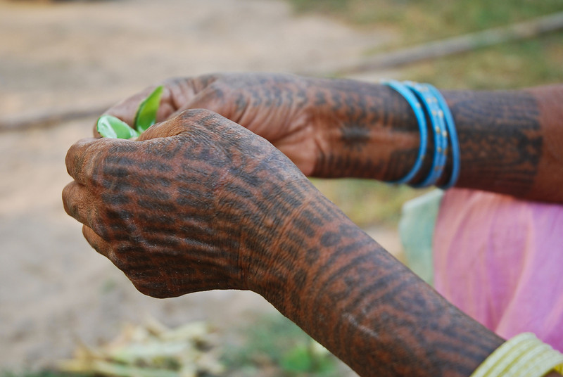 The local tribal women would tattoo parts of their bodies when they married. Traditionally a ring would have been removed upon death whereas tattoos could be taken into death.