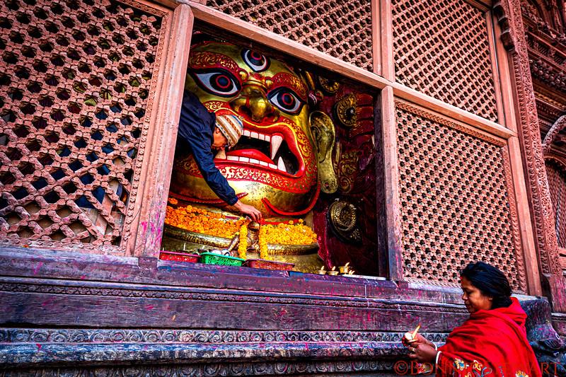 Offerings to the White Blairav statue, reincarnation form of Shiva,  in Durbar Square in Kathmandu