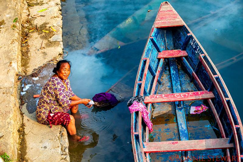 Lady doing her laundry in Lake Fewa