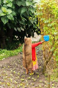 Farm Worker Wearing Traditional Wool Rain Poncho