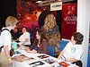 "Marina Sirtis tries to ignore the Wookie stalking her at ""Screenheroes"" Con in Utrecht, Netherlands Sept 25, 2005"