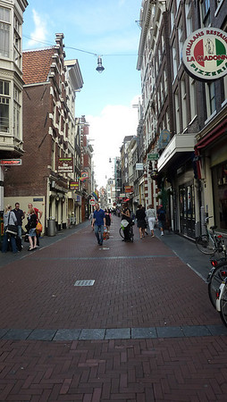 Street scene, our first day in Amsterdam. We weren't able to check into our houseboat until the afternoon so we checked our luggage into lockers at the station and wandered around, had lunch and took a bus tour.