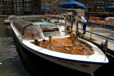 All through the canals of Amsterdam are these long tour boats. They hold about 60 people and run all day from 10am to about midnight. We had them going by our houseboat a lot but it was fun to see the people, not intrusive.