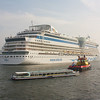 Amsterdam: Aida sol ocean liner with tug and canal cruise boat