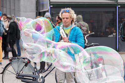 Making soap bubbles.
