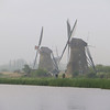 Kinderdijk is located at the convergence of the Noord and Lek rivers.  The windmills were used to drain the Alblasserwaard, a polder.  (A polder is low-lying land that has been reclaimed, by draining the water, for use in agriculture or settlement.)