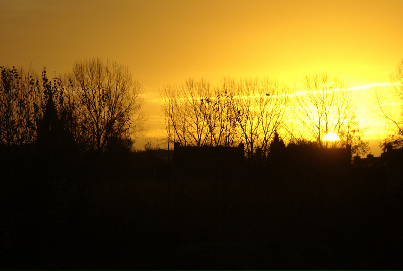 Sunrise in Roermond, The Netherlands, breaking out over the neighboring villages buildings.