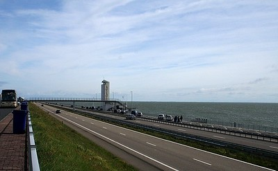 The Afsluitdijk (Enclosing Dike) which closes off the IJsselmeer,  The Zuiderzee itself was an inland lake until Roman times; but during the early Middle Ages the level of the North Sea rose and gigantic storm tides broke through the land and made the Zuiderzee an inlet of the sea. Thereafter the government and people of the Netherlands wrestled with the problem of recovering the land drowned by the sea; but it was not until the 19th century that the technological resources for carrying through such a project became available. After severe food shortages in the Netherlands during the First World War and further heavy damage caused by a storm tide in 1916 the government approved a plan devised by a water engineer named Cornelis Lely, the object of which was twofold - to reclaim land for agriculture and to prevent further penetration by the sea. The construction of the Afsluitdijk had the effect of reducing the length of dikes in the IJsselmeer area by some 300km/185miles.