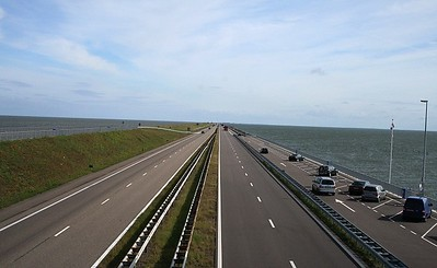 On a clear day you can see forever - the Zuiderzee on the left and the IJsselmeer on the right. I have to say you cannot imagine how huge a task this must have been until you visit this place. At the near (southwestern) end of the Afsluitdijk is a group of sluices, the Stevinsluizen, which control the water level in the IJsselmeer. On the seaward side of the dike are a number of harbor basins enclosed by stone walls.