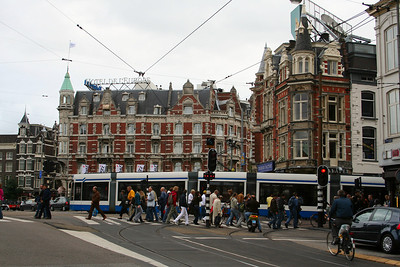 Busy intersection - people, bikes, trams, cars