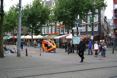 In the street on Rembrandt Square (Rembrandtplein) - love the little taxi bike.