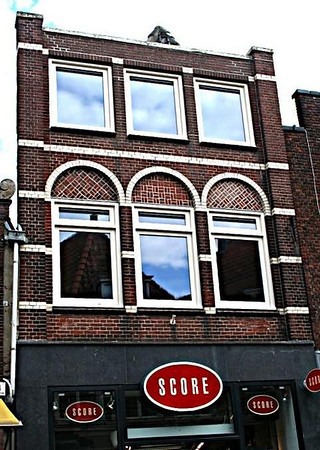 I later discovered there is similar architecture in all the old cities of Holland - but I never ceased to enjoy looking at it. The glass in some of the windows is very, very old, and bumpy - the photo doesn't really portray it