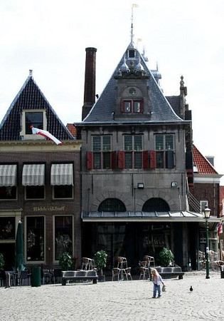 De Waag in Hoorn - Weighing house for goods taken from ships. Waag is an old Dutch name for scales - this building was erected in 1609 and replaced an older building. In the Grand Café on the ground floor you can still see some of the tools which were used at the weigh house, including a bell which rang to indicate the start of the cheese market.