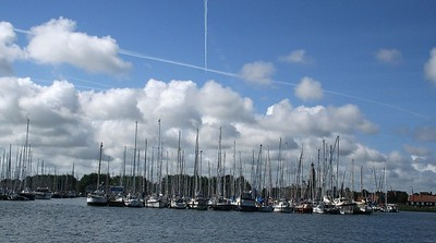 Enkhuizen marina - air flight trails in the sky.