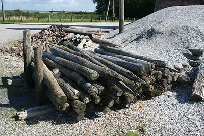 Logs beside a lime heap.