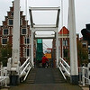 """The Gravestenenbrug is a very old bridge more than 6 centuries old. Its name comes from a castle """"Gravesteen"""" which belonged to a count (graaf) of Holland in the 13dc. The oldest foundations of this bridge are dating from around 1200. The present bridge was build in 1950.<br /> It is a typical """"ophaalbrug"""" on the river Spaarne. What is special with the name of that river is that it is the only river name in the Netherlands which is neutral """"het Spaarne"""""""