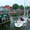 The yacht heading past the big iron de Melkbrug rotating bridge.