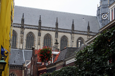 Looking up from the narrow street - can see Oude Sint Bavokerk looming ahead.  Makes you feel very small.