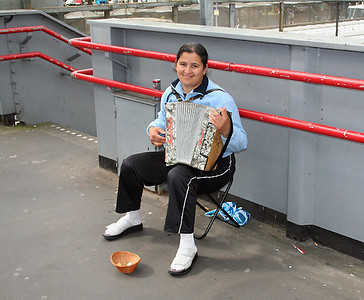 We walked past a young girl playing an accordian on the railway bridge.