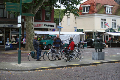 Men around the world find a place in the town square to meet and chat - these blokes congregrate in the middle of the street.
