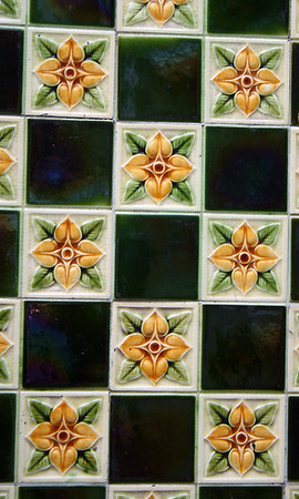 I loved these tiles I saw on a wall in the street.