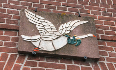 Unusual goose mosiac on a building,