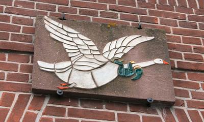 Unusual goose mosiac on a building,