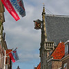 Happy Birthday Hoorn !!! 650 years a city!!!!<br /> The Oosterkerk ('east church') has a facade in Manneristic style, possibly designed by Hendrick de Keyser and built in 1616, but apart from that the building is Gothic. This is the former church of St. Anthonis, built in 1519. Traditionally this was the church of the sailors. Like the Noorderkerk this church has a clock which is positioned like a signboard.