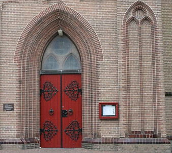Intricate hinges on the giant entrance door of the Sint Martinuskerk, Medemblik.