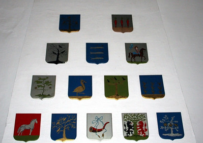 These shields are over the mantlepiece and represent the arms of Westfrisian municipalities.