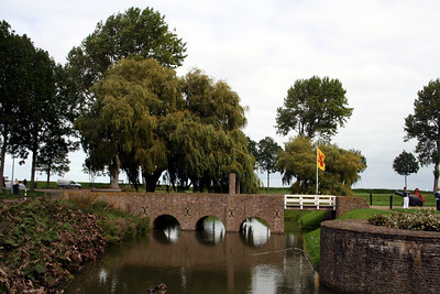 Ancient stone bridge over the moat leading towards Radboud Castle.