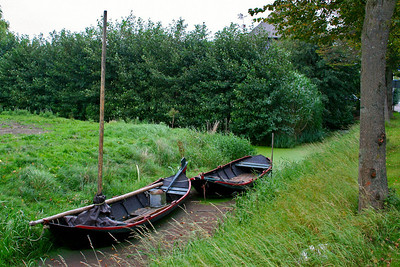 Little boats in the canal beside the main road through Midwoud