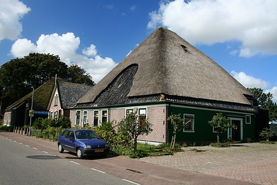 Another house on main road, good example of thatched roof.